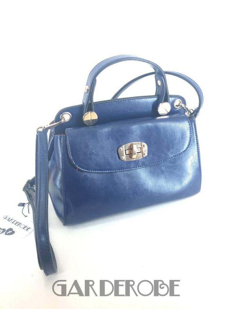 Klein blauw handtasje