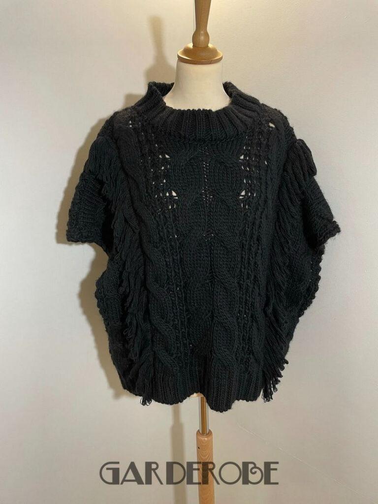 Zwarte overgooi trui met kabels